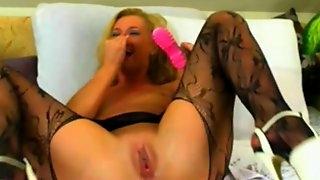 Hot milf pleasures her cunt with boot